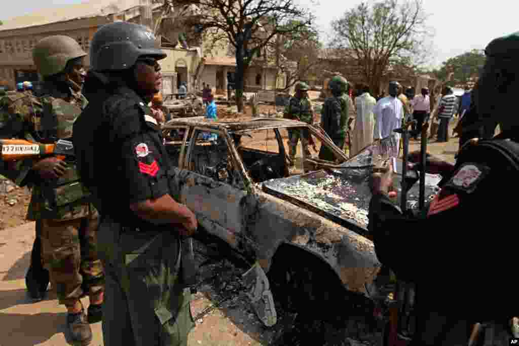 Security forces view the scene of a bomb explosion at St. Theresa Catholic Church at outside Nigeria's capital Abuja, on December 25, 2011. (Reuters)