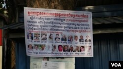FILE- A poster plastered on a tree displays 18 senior CNRP leaders wanted for arrest in Poipet, Banteay Meanchey province, on Nov 7, 2019. (Sun Narin/VOA Khmer)