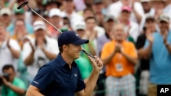 Jordan Spieth celebrates after winning the Masters golf tournament Sunday, April 12, 2015, in Augusta, Ga.