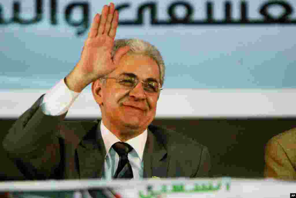 Egyptian presidential candidate Hamdeen Sabahi waves at his supporters during his campaign. He is the only opponent running against former army chief Abdel-Fattah el-Sissi, in Mahalla, 125 kilometers north of Cairo, May 5, 2014.