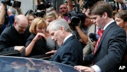 Former Virginia Gov. Bob McDonnell, center, he gets into a car with his son, Bobby, right, after McDonnell and his wife, former first lady Maureen McDonnell, were convicted on multiple counts of corruption at Federal Court in Richmond, Va., Sept. 4, 2014.
