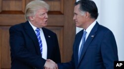 President-elect Donald Trump and Mitt Romney shake hands as Romney leaves Trump National Golf Club Bedminster in Bedminster, N.J., Nov. 19, 2016.