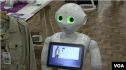 This retail-oriented humanoid robot can read human emotions and speak multiple languages. (R. Taylor/VOA)