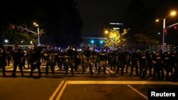 Police in riot gear block a roadway to stop demonstrators from entering a neighborhood as they protest the police shooting of Keith Scott in Charlotte, North Carolina, Sept. 25, 2016.