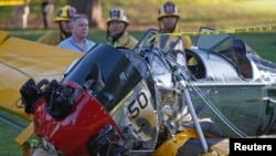 The nose of actor Harrison Ford's vintage airplane shows substantial damage from a crash landing Thursday at Penmar Golf Course in Venice, Calif., March 5, 2015.