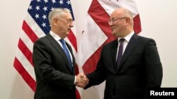 U.S. Secretary of Defense James Mattis, left, greets Georgia's Defense Minister Levan Izoria during a NATO defense ministers meeting at the Alliance headquarters in Brussels, Belgium, Oct. 3, 2018.