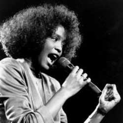 A 22 year-old Whitney Houston performing in Boston, Massachusetts, in 1986