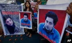 FILE - Members of a Pakistani civil society demonstrate April 22, 2017, in Karachi, Pakistan, against the killing of Mashal Khan, a student at the Abdul Wali Khan University in the northwestern city of Mardan.