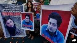 FILE - Members of a Pakistani civil society demonstrate April 22, 2017, in Karachi, Pakistan, against the killing of Mashal Khan, a student at the Abdul Wali Khan University in the northwestern city of Mardan. Police say the lynching of Khan, falsely accu