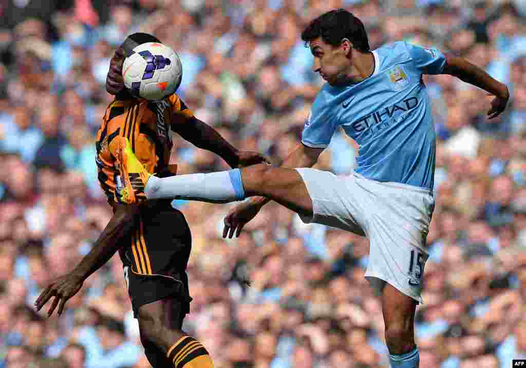 Manchester City's Spanish midfielder Jesus Navas vies with Hull City's Honduran defender Maynor Figueroa (L) during the English Premier League football match between Manchester City and Hull City at Etihad Stadium in Manchester, northwest England. Manchetser City won the game 2-0.