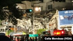 Colonia Roma its one of the areas of Mexico City greatly affected by the earthquake, Sept. 19, 2017. This is an office building where rescuers are trying to get people out of the rubble. Three people were take out alive Wednesday.
