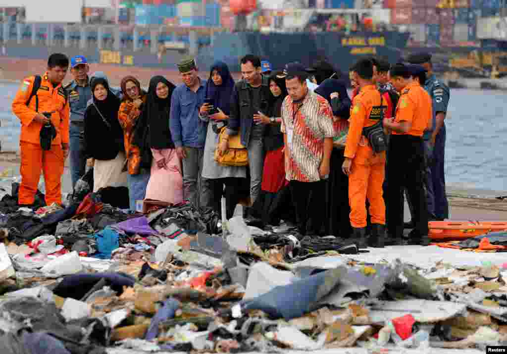 Families of the passengers of crashed Lion Air flight JT610 look at their belongings, at Tanjung Priok port in Jakarta, Indonesia.