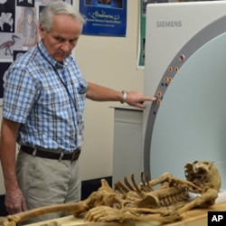 Bruno Frohlich scans mummies in his lab at the Smithsonian Institution National Museum of Natural History in Washington.