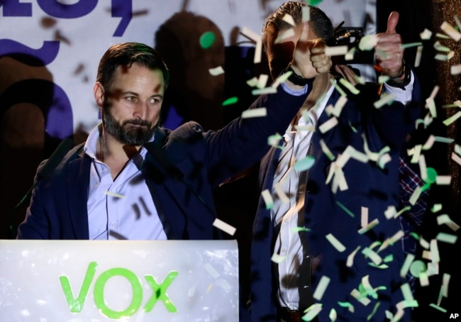 Santiago Abascal, leader of far right party Vox, gestures supporters gathered outside the party headquarters following the general election in Madrid, Sunday, April 28, 2019.