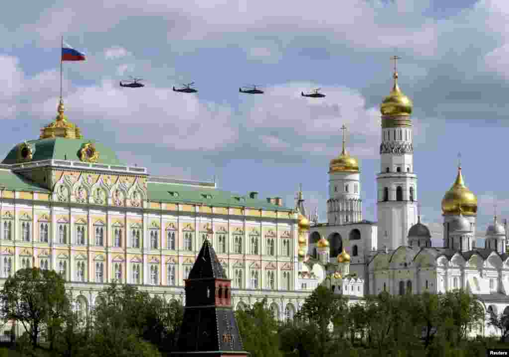 Russian military helicopters fly in formation during rehearsals for the Victory Day military parade, with the Kremlin and the Ivan the Great Bell Tower seen in the foreground, in central Moscow. Russia marks their victory over Nazi Germany in World War II on May 9.