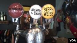 The tap at the Stanley Beer Yard in Johannesburg, South Africa. Lucy Corne, the author of African Brew, expects the number of craft breweries in the country to top 100 next year. (Peter Cox for VOA)