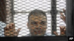 FILE - Mohammed Badr, a cameraman for Al-Jazeera Mubasher Misr, shown in a Cairo court.