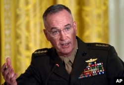 FILE - Gen. Joseph Dunford, the chairman of the Joint Chiefs of Staff, speaks during the National Space Council meeting in the East Room of the White House in Washington, June 18, 2018.