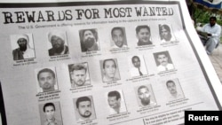 FILE - In notice offering rewards for information leading to the capture of most wanted terrorists, Anas al Liby is bottom row, second from left.