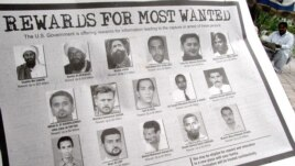 FILE - In notice offering rewards for information leading to the capture of most wanted terrorists,  Anas el-Liby is bottom row, second from left.
