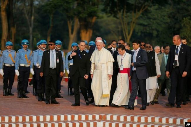 Pope Francis, center, visits the National Martyrs' Memorial of Bangladesh in Savar, outskirts of Dhaka, Bangladesh, Nov. 30, 2017.