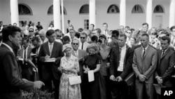 President John F. Kennedy gives a personal farewell message to Peace Corps volunteers in the White House Rose Garden August 28, 1961, before their departure the following day for assignments in Africa