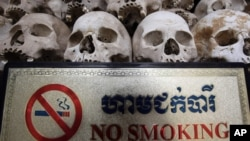 "Human skulls are displayed in the stupa of Choeung Ek, a former Khmer Rouge ""killing field"" dotted with mass graves about nine miles (15 kilometers) south of Phnom Penh, Cambodia."