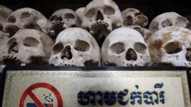 "Human sculls are displayed in the stupa of Choeung Ek, a former Khmer Rouge ""killing field"" dotted with mass graves about nine miles (15 kilometers) south of Phnom Penh,"