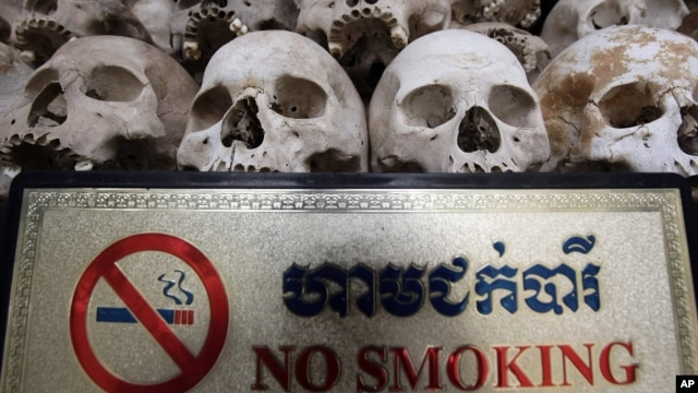 """Human sculls are displayed in the stupa of Choeung Ek, a former Khmer Rouge """"killing field"""" dotted with mass graves about nine miles (15 kilometers) south of Phnom Penh, file photo."""