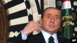 Italian Prime Minister Silvio Berlusconi gestures during a press conference, April 4, 2011