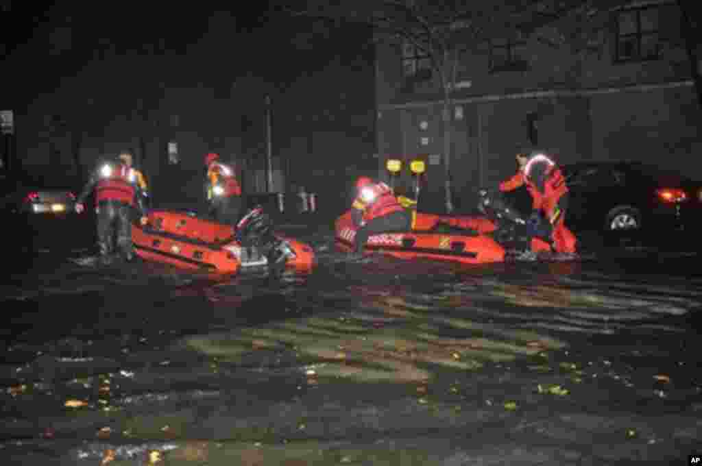 FDNY inflatable boats travel along 14th street towards the East River on a rescue mission in the wake of Hurricane Sandy, October 29, 2012, in New York.