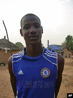Sixteen-year-old Oumar Alassane Ba is a Senegalese-born, Mauritanian refugee, who is the top student at his community high school and was named best overall student in the region, in Ndioum, Senegal, November 2011.
