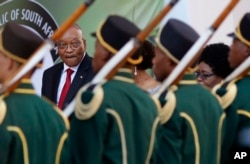 South African President Jacob Zuma, background left, reviews the guard of honor at Parliament in Cape Town, South Africa, Feb. 9, 2017, South African police and military forces on Thursday deployed ahead of Zuma's annual speech before lawmakers.