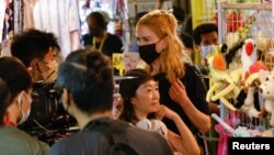 """FILE - Australian actor Nicole Kidman works on a scene during filming for the Amazon Prime series """"Expats"""" in Hong Kong, China, August 23, 2021."""