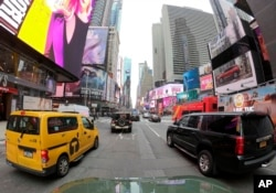 Motorists roll south on 7th Avenue in Times Square, Friday, March 29, 2019, in New York. A congestion toll that would charge drivers to enter New York City's central business district is a first for an American city. (AP photo)