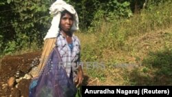 A tea plucker at work on the Priyadarshini Tea Environs plantation in Wayanad, India, December 27, 2019. (Thomson Reuters Foundation/Anuradha Nagaraj)