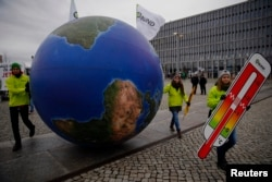 Protesters demonstrate during a rally ahead of the Paris Climate Summit, in Berlin, Germany, Nov. 29, 2015.