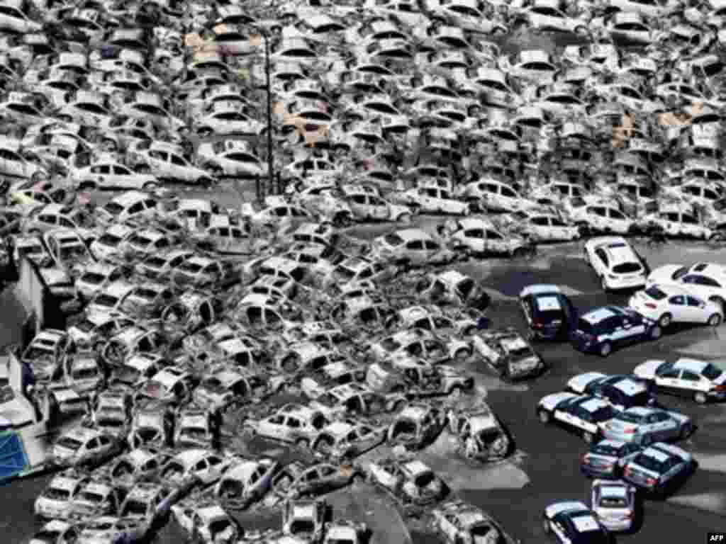 In this photo taken Friday, March 11, 2011, an aerial view shows vehicles washed away by an earthquake triggered tsunami in Hitachinaka, Ibaraki prefecture, Japan.