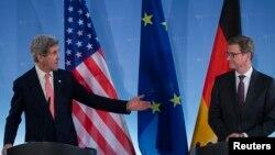 John Kerry, izquierda, junto a su homólogo alemán Guido Westerwelle coinciden en que es necesario que Irán se abra al diálogo.