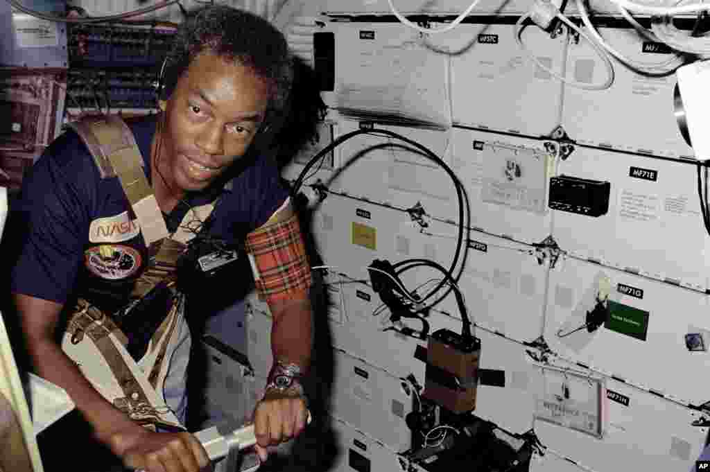 August 30 - September 5, 1983: The first African-American astronaut, Guion Bluford, joins the crew for Challenger's third mission. This shuttle carried out the program's first night launch and night landing. In this photo, Bluford is restrained by a har
