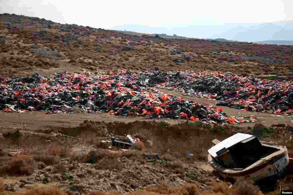 Thousands of lifejackets left by migrants and refugees are piled up at a garbage dump site near the town of Mithymna (also known as Molyvos) on the island of Lesbos, Greece, Oct. 5, 2016.