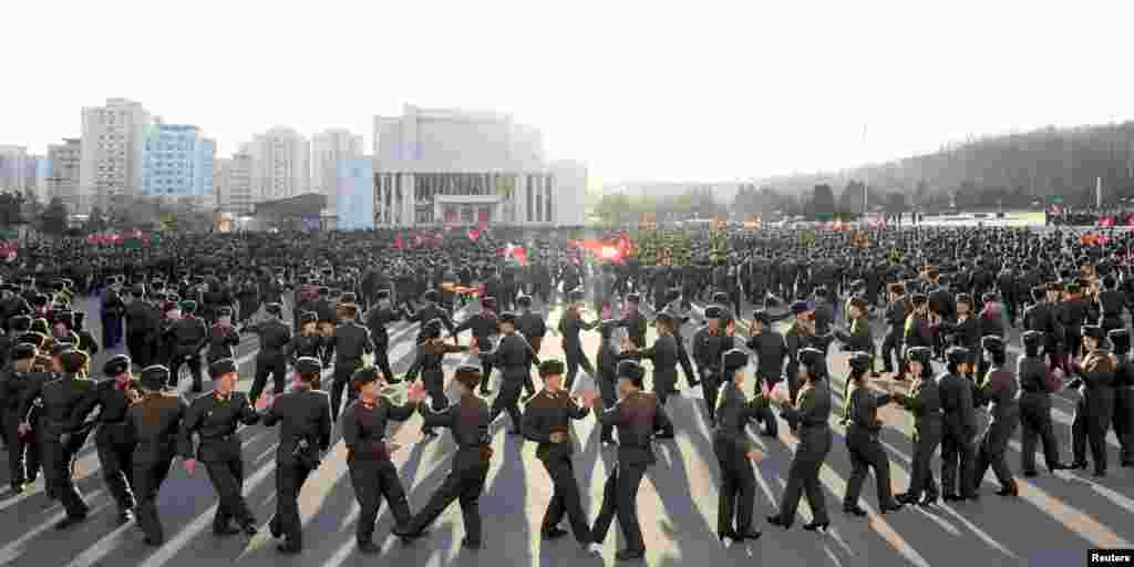 Members of North Korea's Ministry of the People's Armed Forces (MPAF) dance during a celebration of the anniversary of the founding of the regular revolutionary armed forces of Korea, at an undisclosed location  in Pyongyang in this undated photo released by North Korea's Korean Central News Agency (KCNA).