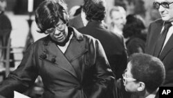 FILE- In this May 27, 1974 file photo, Ella Fitzgerald, left, and jazz pianist Billy Taylor talk during funeral services for Duke Ellington at St. John the Divine Cathedral in New York