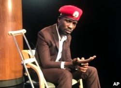 FILE - Ugandan pop star-turned-lawmaker Bobi Wine attends the National Press Club in Washington, Sept. 6, 2018.