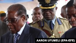 ZIMBABWE ARMY TAKES CONTROL OF GOVERNMENT -- Zimbabwean President Robert Mugabe (C) makes his first public appearance four days after the Zimbabwe National Army (ZNA) took over control of government in Harare, Zimbabwe, 17 November 2017.