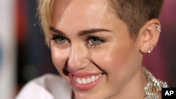 Recording artist Miley Cyrus attends an album release signing event, on Oct. 8, 2013 at Planet Hollywood in New York.