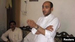 Ali Haider Gilani, son of former Pakistani Prime Minister Yusuf Raza Gilani, who is contesting in the upcoming general election, speaks during a campaign meeting at a house on the outskirts of Multan, May 9, 2013, before his abduction by unidentified gunm