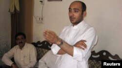 FILE - Ali Haider Gilani, son of former Pakistani Prime Minister Yusuf Raza Gilani, at a campaign meeting at a house on the outskirts of Multan, May 9, 2013, before his abduction by unidentified gunman.