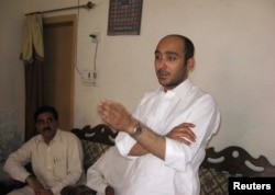 FILE - Ali Haider Gilani speaks during a campaign meeting at a house on the outskirts of Multan, May 9, 2013, before his abduction by unidentified gunmen.