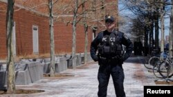 A police officer stands guard outside of John Joseph Moakley United States Courthouse in Boston, Massachusetts on May 1, 2013.